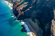 Na Pali Coast sea cliffs above Honopu Beach seen via helicopter over island of Kauai, Hawaii, USA. Kalalau Beach is at upper left.