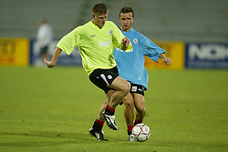 BANGKOK, THAILAND - Wednesday, July 23, 2003: Liverpool's Neil Mellor and Vladimir Smicer during a training session in at the Rajamangala National Stadium. (Pic by David Rawcliffe/Propaganda)