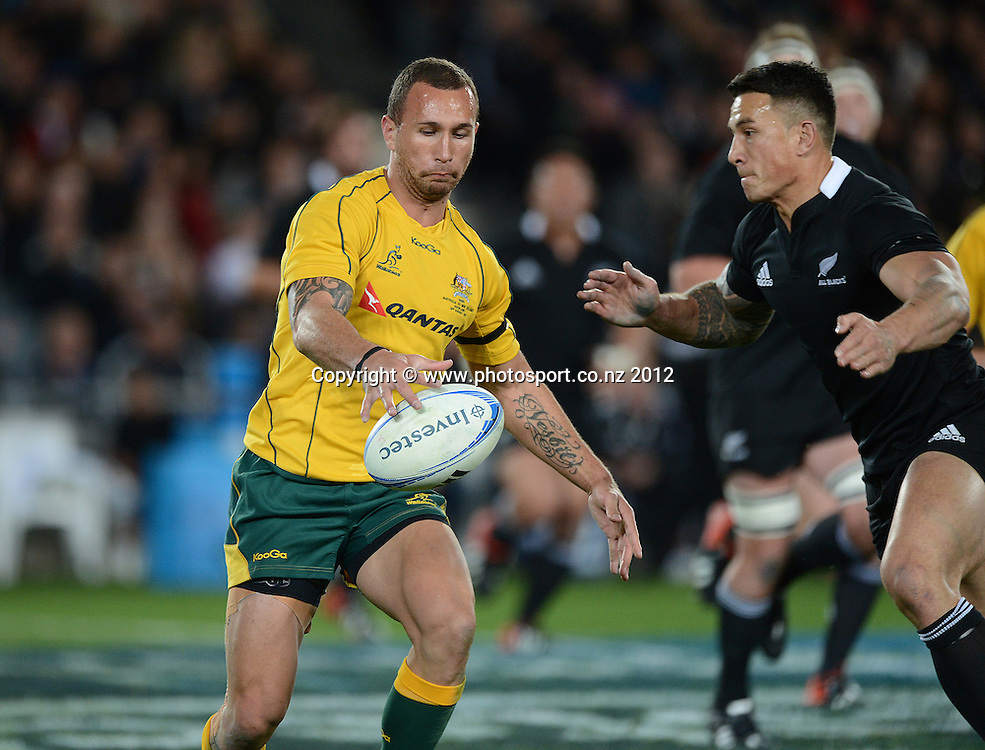 Quade Cooper is lined up by Sonny Bill Williams during the Rugby Championship and Bledisloe Cup Rugby Union test match, New Zealand All Blacks versus Australian Wallabies at Eden Park, Auckland, New Zealand. Saturday 25 August 2012.  Photo: Andrew Cornaga/Photosport.co.nz