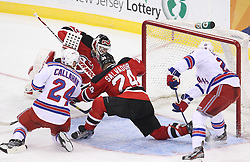 Mar 6; Newark, NJ, USA; New Jersey Devils defenseman Bryce Salvador (24) blocks a shot by New York Rangers right wing Ryan Callahan (24) during the third period at the Prudential Center. The Devils defeated the Rangers 4-1.