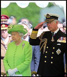 Image ©Licensed to i-Images Picture Agency. 06/06/2014. Bayeux, France. <br /> In the frame - The Queen and The Prince of Wales.<br />  The Queen and The Duke of Edinburgh accompanied by The Prince of Wales and The Duchess of Cornwall attend a service of Remembrance at the Commonwealth War Graves Cemetery in Bayeux, Normandy, France, on the 70th anniversary of D-Day.  Picture by Stephen Lock  / i-Images