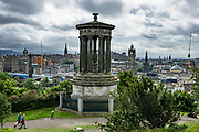The 1831 Dugald Stewart Monument honors Scottish philosopher and mathematician Dugald Stewart (1753–1828) on Calton Hill, Edinburgh, Scotland, United Kingdom, Europe. Dugald Stewart was a professor at the University of Edinburgh, holding the chair of moral philosophy from 1786 until his death, and is best known for popularizing the Scottish Enlightenment. The Royal Society of Edinburgh commissioned this Greek Revival style structure, which is based on the Choragic Monument of Lysicrates in Athens, Greece. It is a circular temple of eight fluted Corinthian columns around an elevated urn.