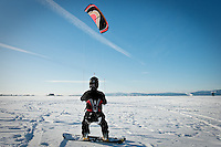 JEROME A. POLLOS/Press..Tony Hall is hoisted up on his snowboard Wednesday, Dec. 6, 2006 by a large kite typically used for kite boarding on rivers and lakes. Hall and his friend Scott Owbridge took advantage of the light wind and clear, blue skies to carve a few turns on the Rathdrum Prairie.