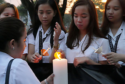 September 21, 2016 - Quezon, National Capital Region, Philippines - Lighting of the candle from the Eucharistic candle..Miriam College held a Eucharistic Mass in memory of the people who died during the war on drugs. Candles are light up in their memory and a march to Katipunan Avenue to a pedestrian overpass. This is also in celebration of International Day of Peace by the students and faculty of Miriam College with a theme ''Mahalaga ang Buhay' (Credit Image: © George Buid/Pacific Press via ZUMA Wire)