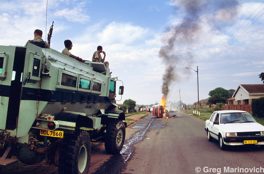 KwaZulu Natal, South Africa, 1994. Police armoured vehicles in Section A KwaMashu Hostel, an Inkatha stronghold.