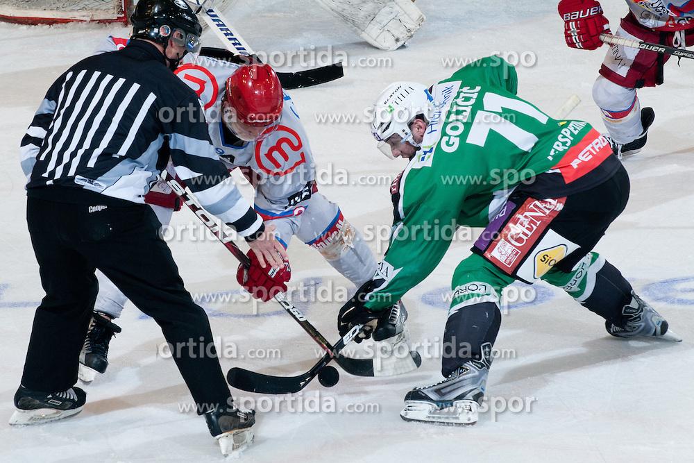 Bostjan Golicic (HDD Tilia Olimpija, #71) vs Marc Cavosie (HK Acroni Jesenice, #9) during ice-hockey match between HDD Tilia Olimpija and HK Acroni Jesenice in second game of Final at Slovenian National League, on April 3, 2011 at Hala Tivoli, Ljubljana, Slovenia. (Photo By Matic Klansek Velej / Sportida.com)