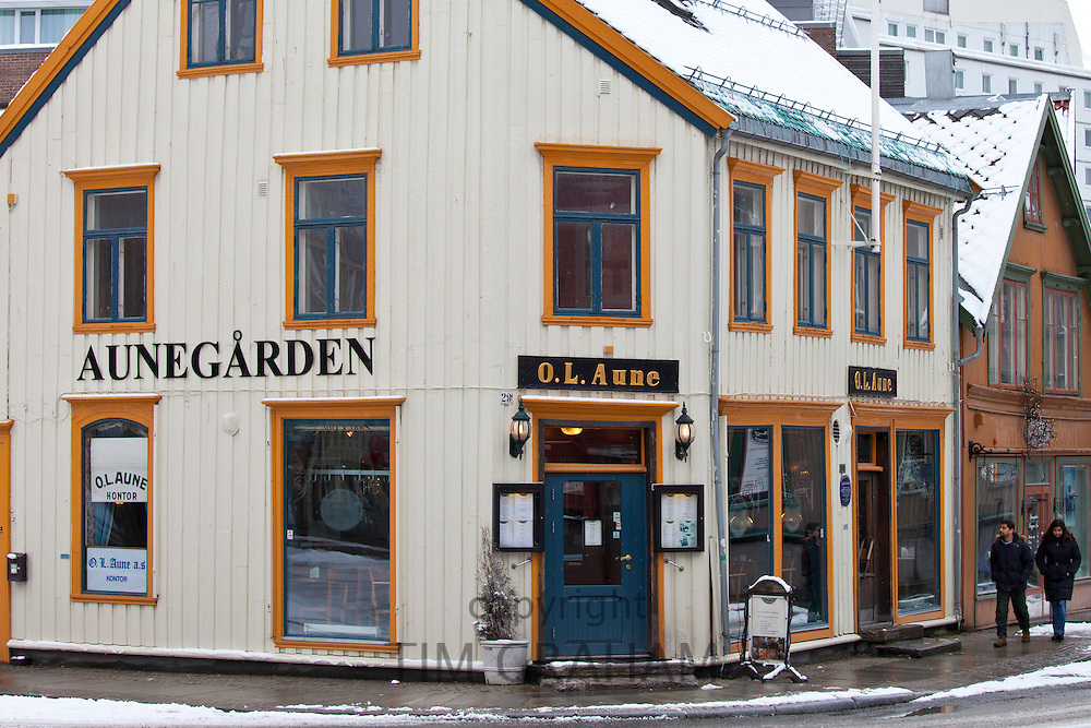 Street scene and quaint Aunegarden Restaurant in Storgata in city of Tromso, in the Arctic Circle in Northern Norway