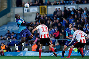 Adebayo Akinfenwa of Wycombe Wanderers heads the ball during the EFL Sky Bet League 1 match between Wycombe Wanderers and Sunderland at Adams Park, High Wycombe, England on 19 October 2019.