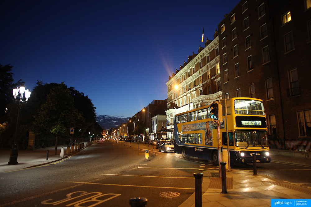 A  Dublin Street Scene at night near St. Stephen's Green showing a public transport bus. Dublin, Ireland. Photo Tim Clayton