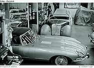BritSport shop floor. 1967 Jaguar E Type in foreground. Triumph 1800 Roadster in background.