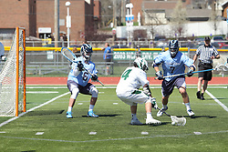 11 April 2015:  Alex Lambert works on goalie Nick Bonastia  and Jacob Cambron during an NCAA Division III mens lacrosse match between the Elmhurst Bluejays and the Illinois Wesleyan Titans in Bloomington IL