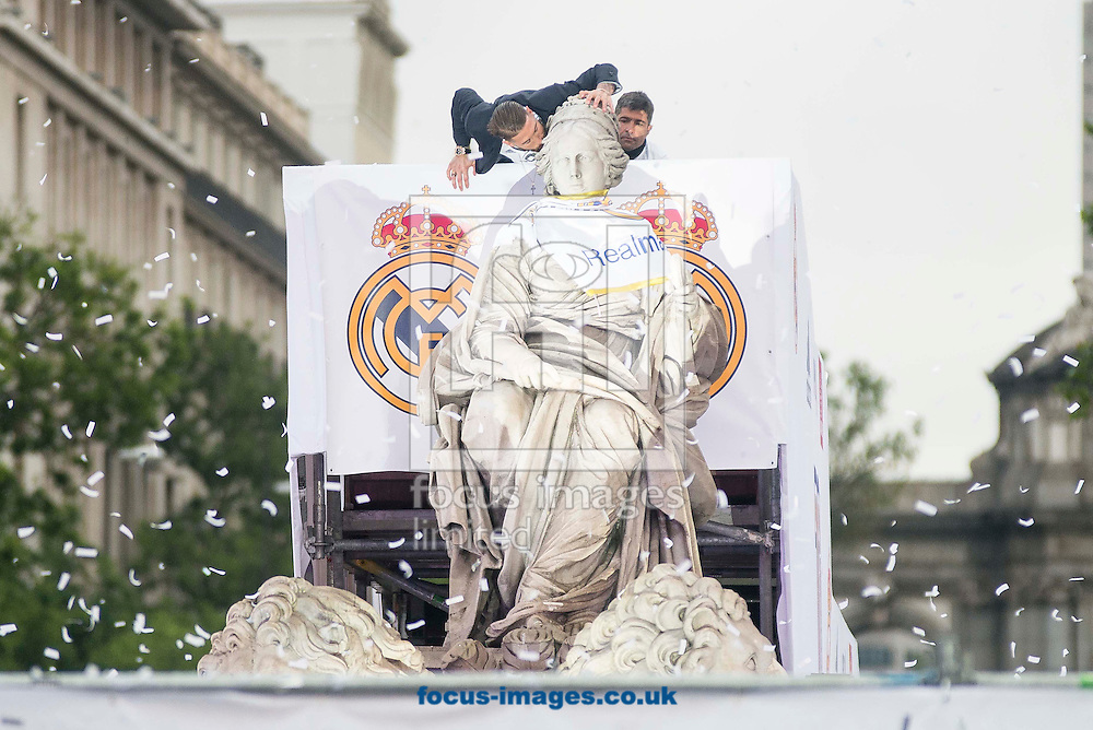 Real Madrid players celebrate winning the UEFA Champions League with an open top bus tour at Cibeles Square, Madrid<br /> Picture by EXPA Pictures/Focus Images Ltd 07814482222<br /> 29/05/2016<br /> ***UK &amp; IRELAND ONLY***<br /> EXPA-ESP-160529-0123.jpg