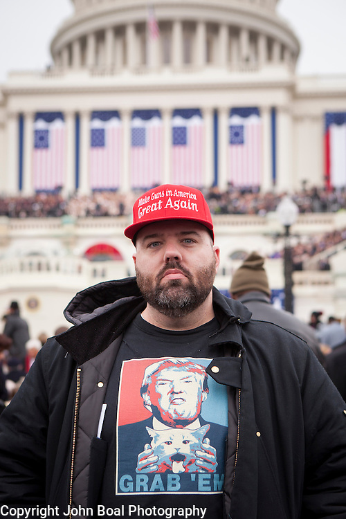 """Daryl Bowler, traveled from Orange County, CA to attend the Inauguration of Donald Trump as the 45th President of the United States, January 20, 2017.  While he originally supported Rand Paul, he said the last thing he wanted was another Clinton in office.  When asked about his hopes for the Trump administration he replied, """"I hope the world doesn't burn down...""""  But as a railroad worker dependent on the coal industry he added, """"...I hope he brings jobs back.  Hillary said she'd kill coal and that would've put me out of work...""""  John Boal Photography"""