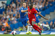 Liverpool forward Sadio Mané (10) battles with Chelsea defender César Azpilicueta (28) during the Premier League match between Chelsea and Liverpool at Stamford Bridge, London, England on 22 September 2019.