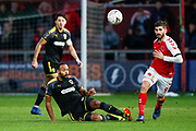 Wimbledon midfielder Liam Trotter (14) clears ahead of Fleetwood Town forward Ched Evans (9) on loan from Sheffield United,   during the The FA Cup 3rd round match between Fleetwood Town and AFC Wimbledon at the Highbury Stadium, Fleetwood, England on 5 January 2019.