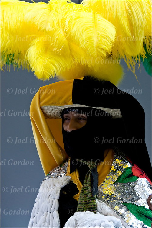 Mexican American showing his culture and ethnic pride dressed in folk costume with mask before the start of the Mexican Day Parade.