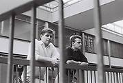 Two friends shot through railings, London, UK, 1986.