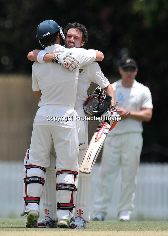 Ed Cowan gets a hug from Matthew Wade after bringing up his 100 during action from Day 3 of the Tour match between Australia A and New Zealand played at Allan Border Field from 24th - 27th November 2011~ Photo Credit Required : Steven Hight (AURA Images) ~ Editorial Use only in accordance with CA Terms & Conditions (2011-12)
