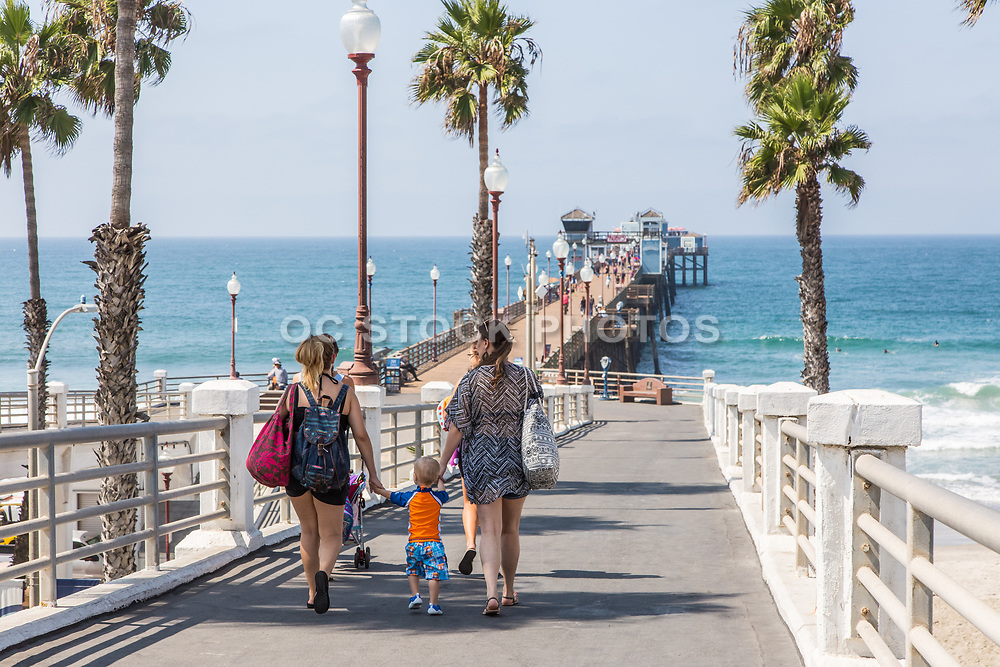 People Walking to Oceanside Pier