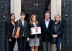 © Licensed to London News Pictures. 16/09/2013. London, UK. Paula Barrow (C), a 45 year old mother of two from Manchester, leads a group of mothers; Katherine Stipala (L), Nicole Elias (2L), Beverley Muir (R) and Peter Saunders, the chief executive of the National Association for People Abused in Childhood (NAPAC) to Number 10 Downing Street in London today (16/09/2013) to deliver a petition calling for a 'Daniel's Law. The petition, which is still open and gathering signatures, asks for a law calling for the mandatory reporting of suspected child abuse by those working with children and is named in the memory of Daniel Pelka, a four year old who starved and beaten for months before he died. Photo credit: Matt Cetti-Roberts/LNP
