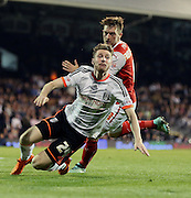 James Husband going down in the box during the Sky Bet Championship match between Fulham and Rotherham United at Craven Cottage, London, England on 15 April 2015. Photo by Matthew Redman.