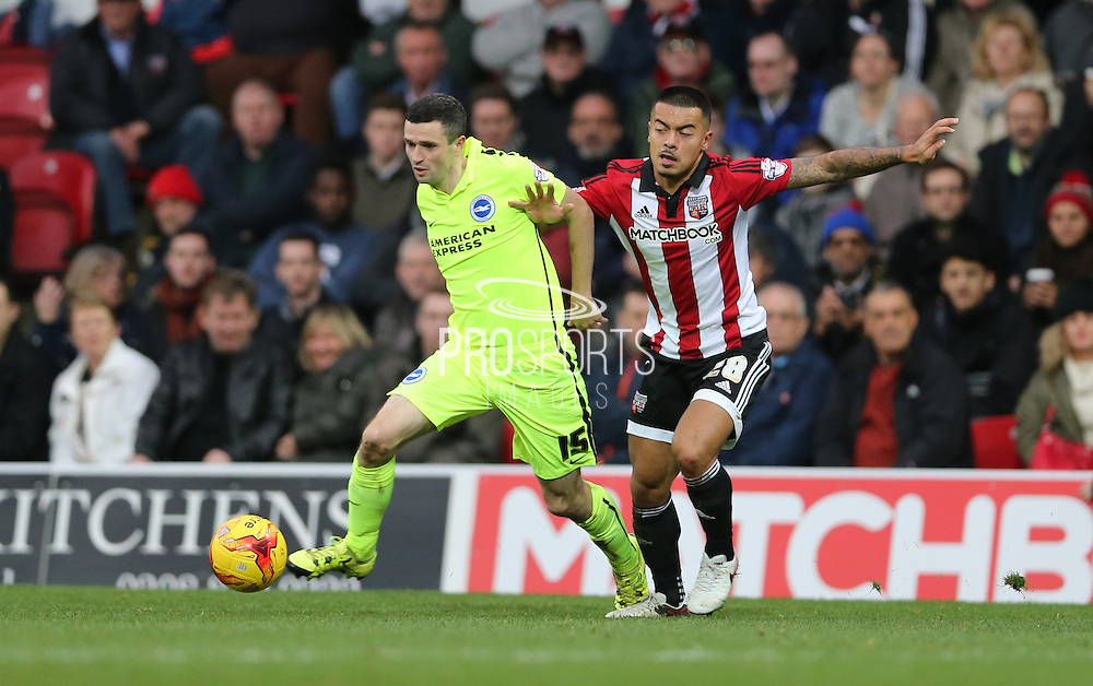 Brighton winger, Jamie Murphy (15) and Brentford defender Nico Yennaris during the Sky Bet Championship match between Brentford and Brighton and Hove Albion at Griffin Park, London, England on 26 December 2015.