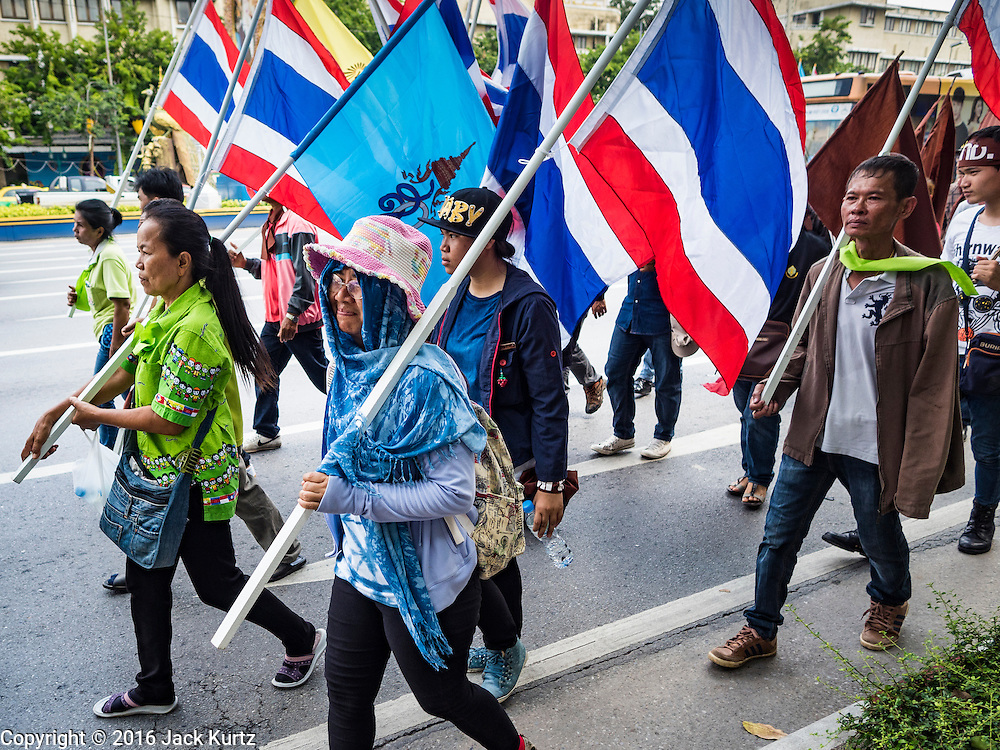 03 OCTOBER 2016 - BANGKOK, THAILAND:  World Habitat Day protesters march through central Bangkok. In 1985, the UN General Assembly declared that World Habitat Day would be observed on the first Monday of October every year.  The declaration noted that every person deserves a decent place to live. In Bangkok this year, hundreds of people marched to the United Nations' offices to deliver a letter addressed to the UN Secretary General noting that forced evictions to facilitate urban renewal and gentrification was resulting in an increase in homelessness and substandard housing. Protesters and housing rights' activists also marched to the Prime Minister's Office and Bangkok city hall to express their concerns.     PHOTO BY JACK KURTZ