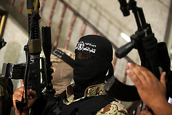 September 27, 2016 - Gaza City, Gaza Strip, Palestinian Territory - Palestinian militants of the Nasser Salah al-Din Brigades the military wing of the Popular Resistance movement take part in a press conference, in Gaza City on Sept. 27, 2016  (Credit Image: © Ashraf Amra/APA Images via ZUMA Wire)