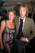 Mr. and Mrs. Rhys Ifans, Evening at Sanderson, 3 June 2003. © Copyright Photograph by Dafydd Jones 66 Stockwell Park Rd. London SW9 0DA Tel 020 7733 0108 www.dafjones.com