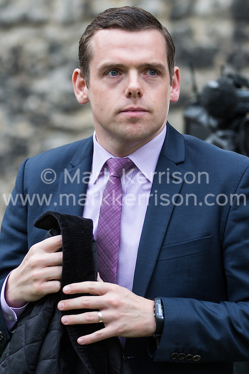 London, UK. 8 May, 2019. Douglas Ross, Scottish Conservative MP for Moray, walks across College Green in Westminster following an interview.