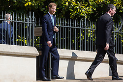 Windsor, UK. 21st April 2019. The Duke of Sussex leaves St George's Chapel in Windsor Castle after attending the Easter Sunday service.