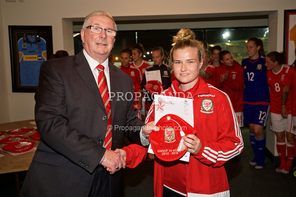 CARDIFF, WALES - Friday, August 19, 2016: Wales' Hannah Miles is presented with her Under-19 cap by FAW President David Griffiths at Rodney Parade. (Pic by David Rawcliffe/Propaganda)