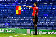 Assistant Referee Bhupinder Gill flags for off-side during the EFL Trophy match between Southend United and AFC Wimbledon at Roots Hall, Southend, England on 13 November 2019.