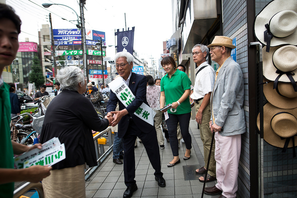 TOKYO, JAPAN - JULY 6 : Toshio Ogawa a candidate from Democratic Party of Japan (DPJ) shakes hands with the supporters during the Upper House election campaign outside of Machiya Station, Tokyo prefecture, Japan, on July 6, 2016. (Photo by Richard Atrero de Guzman/NUR Photo)