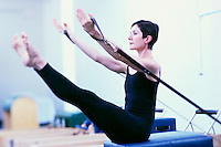 Woman Doing Pilates Exercises --- Image by © Jim Cummins/CORBIS