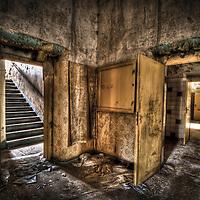 Abandoned lunatic asylum north of Berlin, Germany. Room with open door.