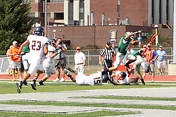 28 September 2013:  Artie Checchin flies over a pair of Flying Dutchmen into the end zone during an NCAA division 3 football game between the Hope College Flying Dutchmen and the Illinois Wesleyan Titans in Tucci Stadium on Wilder Field, Bloomington IL