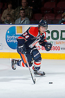 KELOWNA, CANADA - DECEMBER 27: Mitch Lipon C #34 of the Kamloops Blazers skates with the puck against the Kelowna Rockets on December 27, 2013 at Prospera Place in Kelowna, British Columbia, Canada.   (Photo by Marissa Baecker/Shoot the Breeze)  ***  Local Caption  ***