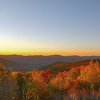 The abundance of glorious autumn colors attracts travelers from all over the world to New England. From Maine Baxter State Park to Acadia National Park to the New Hampshire White Mountains and the Green Mountains in Vermont to the Berkshires in Western Massachusetts fall foliage usually peaks from end of September in northern Maine and the higher elevations to mid October in the beautiful the Berkshires and the Boston area. A hike or drive up Mount Greylock is one of the many things to do in the Berkshires. There are multiple scenic overlooks when climbing the Mount Greylock Summmit Road in your car. This sunset photography image was taken from the Ashford overlook. The Berkshires is a rural region in the mountains of western Massachusetts dotted with villages and towns. It is popular vacation destination and it's known for outdoor activities, fall foliage tours and viewing, a farm-to-table food scene and thriving arts institutions. <br />