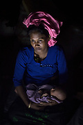 Sunday 12 November 2017. After 16 - 20 days waiting on the Myanmar border, Mubina Khatun, and her seven-day-old-baby, crossed the Naf River into Bangladesh on one of eight makeshift rafts. With the help of family members, to reach the border, she walked through a forest and crossed over a mountain while 9 months pregnant. Mubina left her home after her village was attacked by the Myanmar military. <br /> <br /> Often described as the &quot;world's most persecuted minority&quot;, the Rohingya are a Muslim ethnic group from the Rakhine State in Myanmar. In October 2016, a military crackdown in the wake of a deadly attack on an army post sent hundreds of thousands of Rohingya fleeing to neighbouring Bangladesh. Similar attacks in August 2017 led to the ongoing military crackdown, which has led to a new mass exodus of Rohingya. <br /> <br /> So far more than 650,000 people have fled into Bangladesh, swelling the refugee camps and creating a humanitarian crisis. Photograph by David Dare Parker