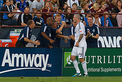 July 20, 2011; Santa Clara, CA, USA;  Vancouver Whitecaps forward Eric Hassli (29) celebrates with teammates on the sidelines after scoring a goal against the San Jose Earthquakes during the first half at Buck Shaw Stadium.