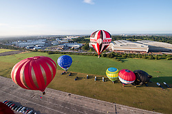 © Licensed to London News Pictures. 29/07/2019; Bristol, UK. Press preview event for the 41st Bristol International Balloon Fiesta 2019 which will take place from 08 - 11 August 2019. For the preview up to 25 hot air balloons will take off from Filton Airfield, next to the Brabazon Hangar (pictured in background) which is the site of a proposed new YTL Arena, and Aerospace Bristol to play homage to the 50th anniversary of Concorde. The Bristol International Balloon Fiesta attracts hundreds of thousands of visitors and this year the Fiesta will be celebrating Icons of Bristol and look to highlight some of the things that make up the home of the International Balloon Fiesta. The event has joined forces with Aerospace Bristol to honour one of the city's most famed creations, Concorde and Aardman Animations who are celebrating the 30th anniversary of Wallace and Gromit. Over the course of four days, the Bristol International Balloon Fiesta will play host to more than 100 colourful hot air balloons of all sizes and shapes. Special shapes are an iconic part of the Fiesta and the event kicks off with its now traditional special shapes launch on Thursday evening of 08 August. Photo credit: Simon Chapman/LNP.