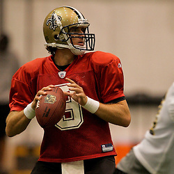 12 August 2009: New Orleans Saints quarterback Drew Brees (9) drops back to pass during New Orleans Saints training camp at the team's indoor practice facility in Metairie, Louisiana.