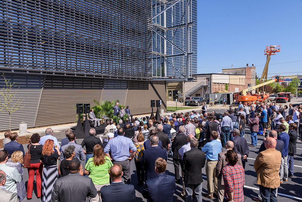 Guests gather as Rabbit Hole Distillery, at 711 E. Jefferson Street in NuLu, hosts a ribbon-cutting, grand opening party and a peek inside before opening to the public sometime in June. May 1, 2018