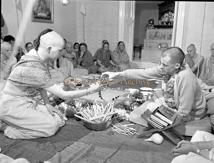 Hare Krishna Initiation, Dublin.02.05.1982..05.02.1982.2nd May 1982.1982.At the Hare Krishna Temple,Castlefield House,Knocklyon Rd,Templeogue,Dublin,new members are initiated into the Hare Krishna movement. The initiation was conducted by Guru His Divine Grace, Srila Satswarupa Das Goswami..A new member accepts the traditional offering of beads before his initiation.