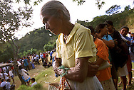 A woman waits in line for medical supplies in a mountaintop village near the Los Colinas neighborhood of San Salvador, El Salvador on Thursday, January 25, 2001. A massive earthquake a week earlier killed over 600 people and left thousands homeless.