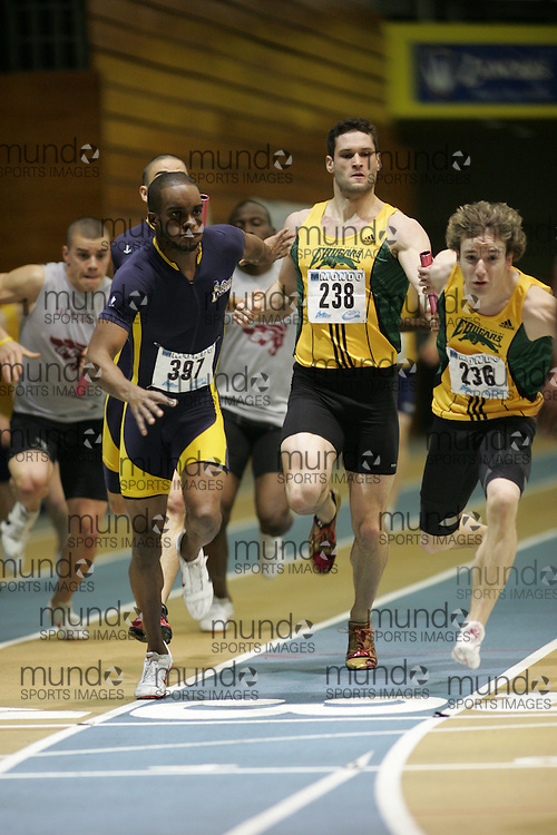 (Windsor, Ontario---13 March 2010) Chris Reid of University of Windsor Lancers   competes in the men's 4x200m relay final at the 2010 Canadian Interuniversity Sport Track and Field Championships at the St. Denis Center. Photograph copyright Sean Burges/Mundo Sport Images. www.mundosportimages.com
