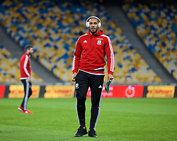 KIEV, UKRAINE - Easter Monday, March 28, 2016: Wales' captain Ashley Williams inspects the pitch ahead of the International Friendly match against Ukraine at the NSK Olimpiyskyi Stadium. (Pic by David Rawcliffe/Propaganda)
