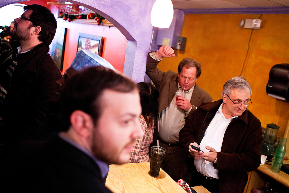 Former Republican gubernatorial candidate Carl Paladino, right, listens from the back of the room during a town hall meeting with Republican presidential candidate Newt Gingrich at Don Quijote restaurant on Sunday, January 8, 2012 in Manchester, NH. Brendan Hoffman for the New York Times