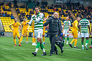 Christopher Jullien (#2) of Celtic FC leaves the field with the Celtic physiotherapist during the Ladbrokes Scottish Premiership match between Livingston FC and Celtic FC at The Tony Macaroni Arena, Livingston, Scotland on 6 October 2019.